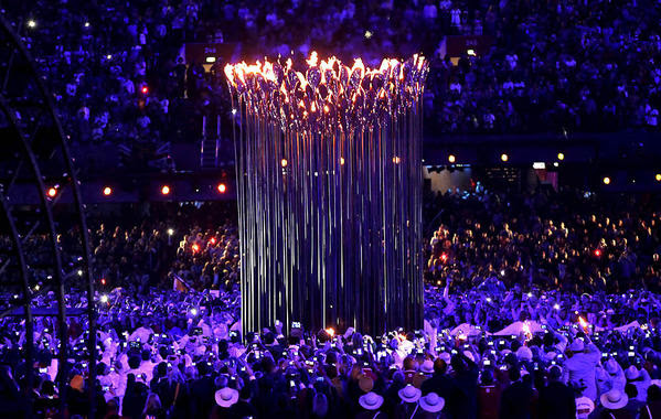 A spire of torches burns in the center of Olympic Stadium as the official flame is lit to begin the London 2012 Olympics.