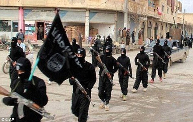 March of death: Clad all in black, the Islamic State killers have become synonymous with death in the region