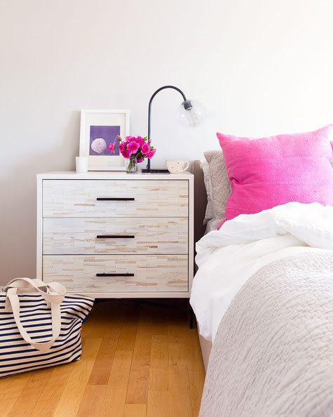 Modern Bedroom - Pink mud cloth pillows on a neutral bed