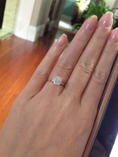 Thin band engagement ring, round brilliant diamond