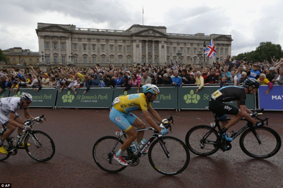 A splendid view: Yellow jersey wearer Vincenzo Nibali (centre) and current champion Chris Froome (right) race past the stunning backdrop of Buckingham Palace
