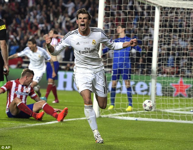 Gareth Bale wheels away in celebration after scoring Real's second goal during the win over Atletico Madrid in the 2014 Champions League final