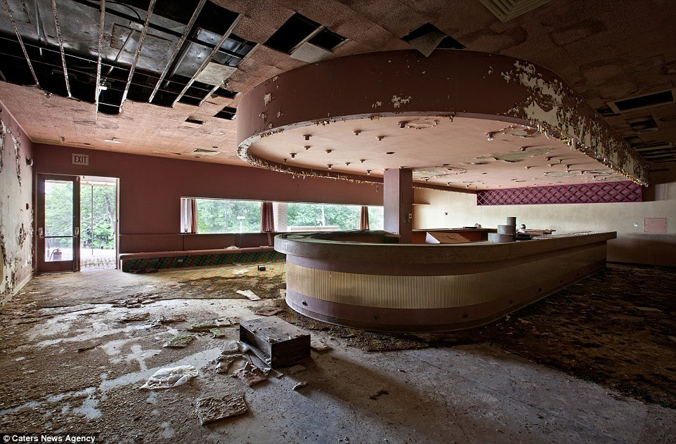 At an unnamed resort, the bar area is slowly falling apart, as revealed in this photo by Matthew Christopher for his new book