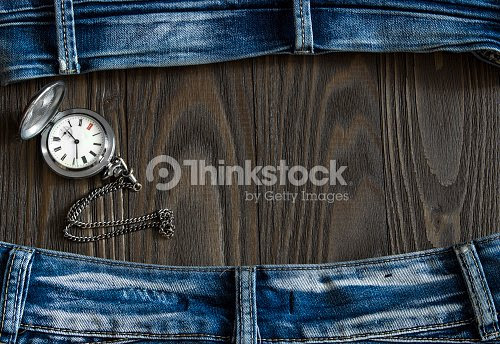 c67c0e5cf Frame Made Of Old Worn Jeans And A Pocket Watch Stock Photo Thinkstock