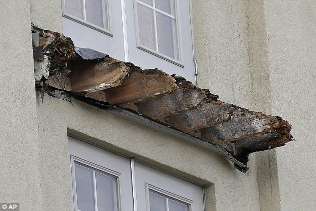 Wooden beams supporting a balcony that snapped off killing the six college students had been badly rotted by exposure to moisture, officials have confirmed
