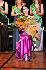 Ailbhe Ryan, representing the Hutt Valley Irish Society with the other contestants receiving the applause of the crowd