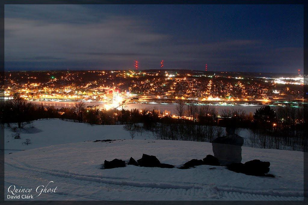 A night view overlooking Houghton, with a ghostly figure looking on.