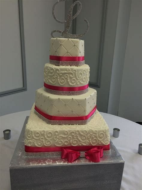 Four tier wedding cake with square, hexagon and round