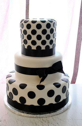 Tri tier round white wedding cake with black pokadots and