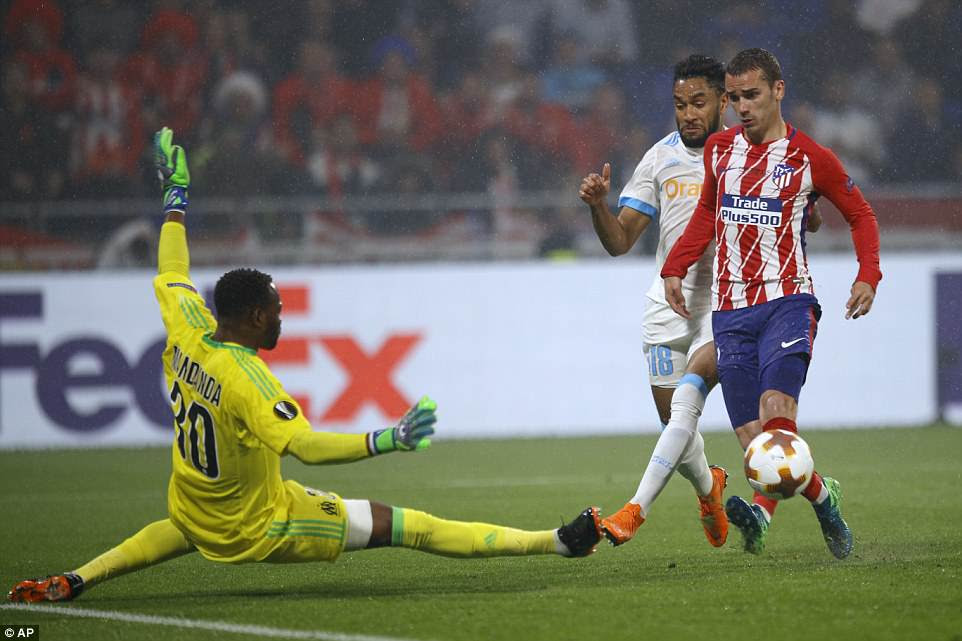 Griezmann chips over a diving Mandanda to double Atletico's lead and put them in touching distance of the final
