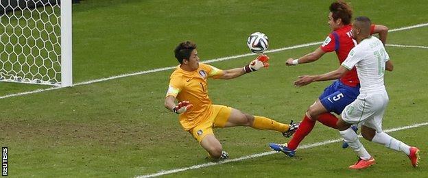 Algeria forward Islam Slimani scores his side's opener against South Korea