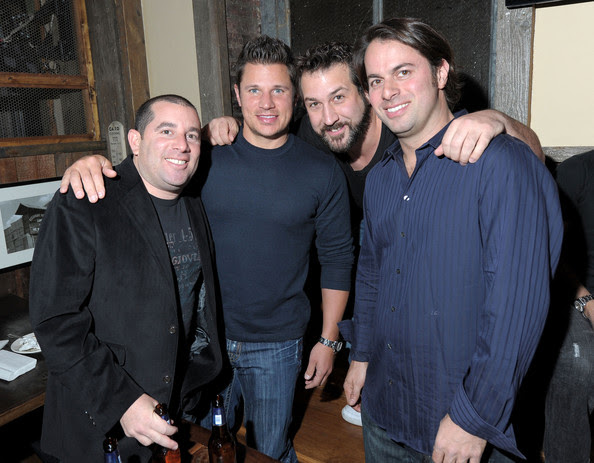 (L-R) Berk Communications founder Ron Berkowitz, singers  Nick Lachey and Joey Fatone and owner of Brother Jimmy's Jeff Lebowitz  attend the Brother Jimmy's Union Square grand opening hosted by Lachey  at Brother Jimmy's on March 10, 2010 in New York City.
