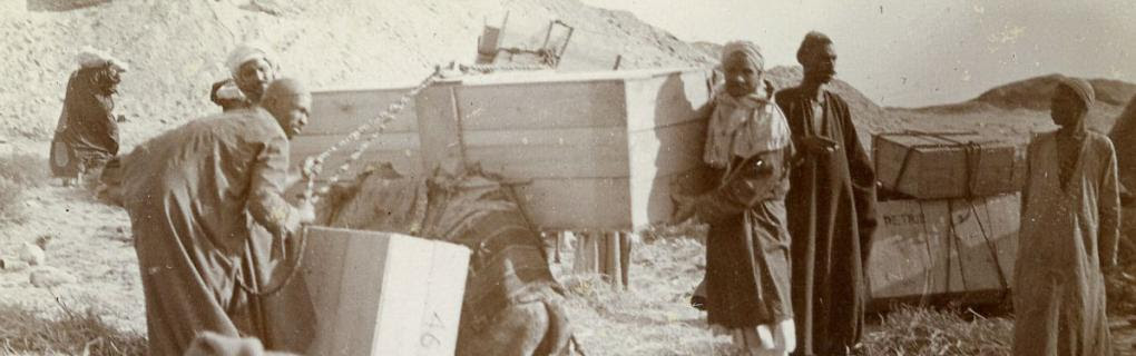 Men packing crates of finds from excavations directed by Flinders Petrie. Date unknown. Petrie Museum archives.