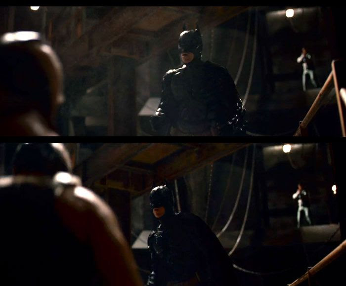 Batman (Christian Bale) confronts Bane in THE DARK KNIGHT RISES.