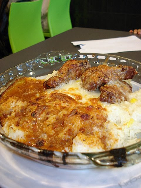 Baked cheese rice with chicken wings, smothered in twin sauce