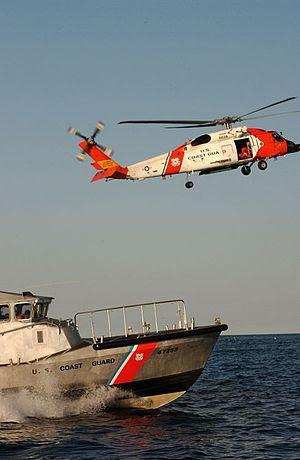U.S. Coast Guard HH-60 and a 47-ft Motor Life Boat