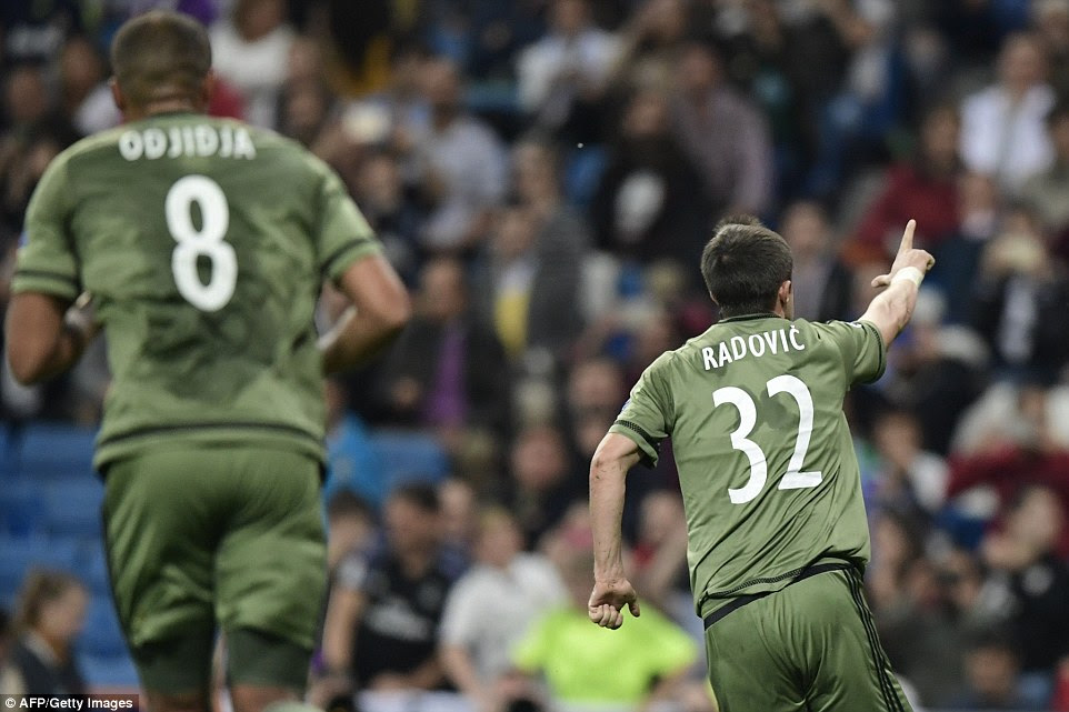 The Legia man points the way after beating Keylor Navas with his penalty to make the score 2-1 at the Bernabeu