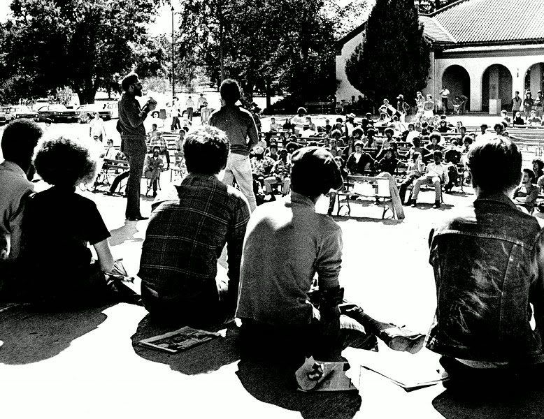 "Description of  SEP 6 1971 - Lauren Watson Addresses A City Park Crowd Of More Than 150 During Memorial Rally For ""SOLEDAD Brother"" George Jackson. Speakers at the Sunday rally charged that Jackson, killed in an attempt to escape from San Quentin prison, was a victim of racism. (Ernie Leyba/The Denver Post)"