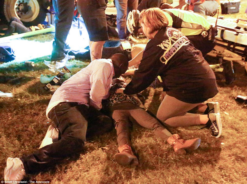 A young child is treated by a paramedic at the the Endymion Parade where 28 were injured and 21 were hospitalized
