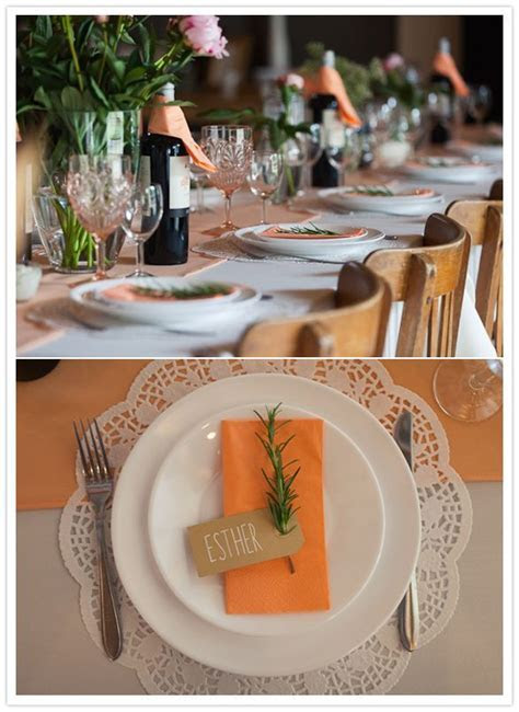 paper doily charger, orange napkins and rosemary plate