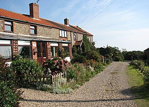 A terrace of brick and flint cottages - geogra...