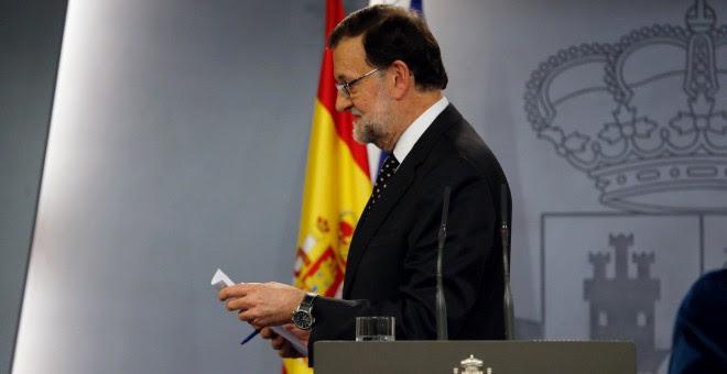 El presidente del Gobierno español en funciones, Mariano Rajoy, tras una rueda de prensa en el Palacio de la Moncloa. EFE/Ballesteros