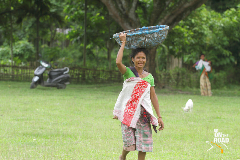 Mishing Tribal woman with fresh fish on her head, Panbari village, Kaziranga, Assam