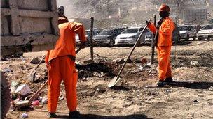 Kabul municipality staff cleaning the city