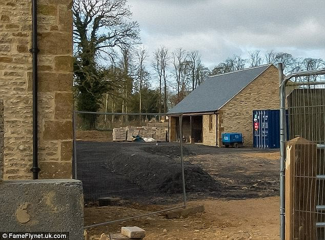 Retreat: The Beckhams bought the property, pictured, in December, as a countryside getaway. The property is close top the exclusive celebrity hangout Soho Farmhouse.