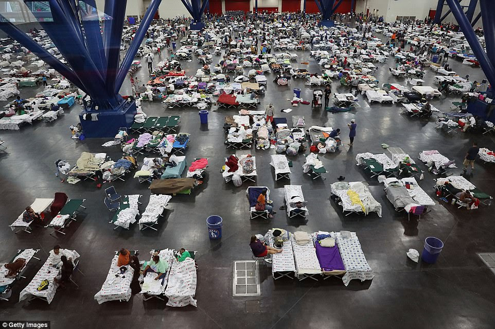 There are 17,000 people in shelters across Texas and more will flock to them as the disaster continues to unfold. Above, the George R. Brown Convention Center on Tuesday morning where 9,000 people are taking shelter