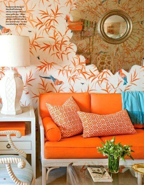 Love this orange couch! Bold home decor choice. #homedecor #wallpaper #decoratingideas