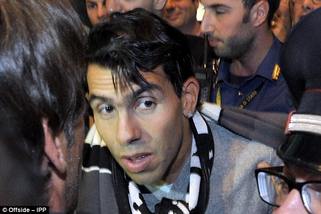 Shaken: Tevez did look slightly taken aback with all the attention