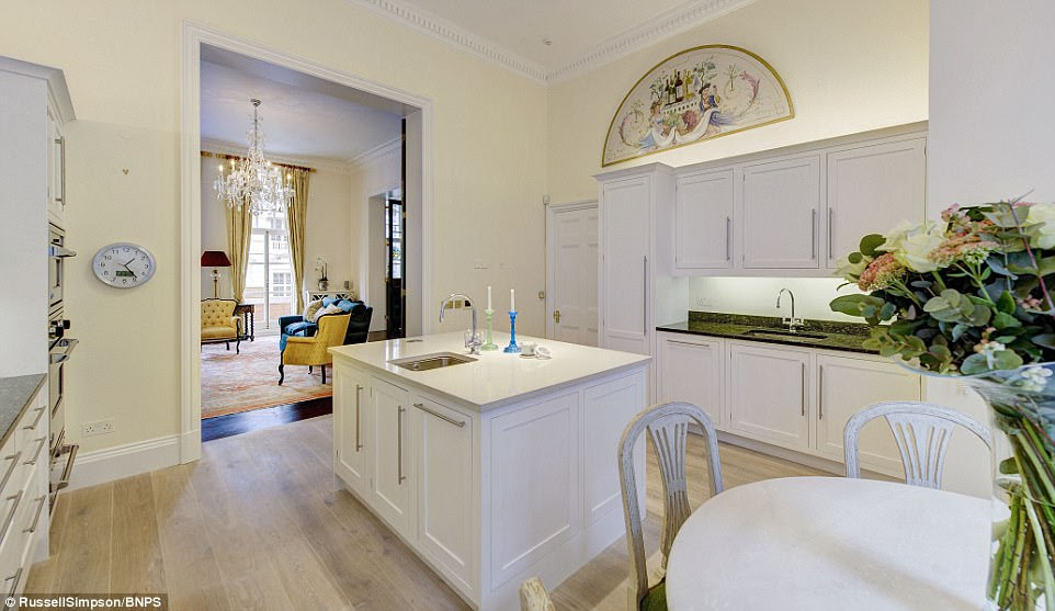 The upper floor has a double reception room with 13ft                high ceilings, intricate cornicing, a fireplace and                chandeliers, as well as a sleek kitchen and a balcony                overlooking the Royal College of Music