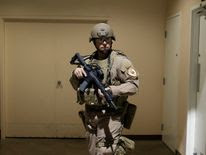 A police officer stands guard backstage following the security scare