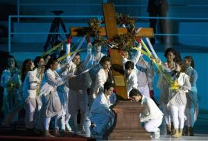 A group places a cross on the stage during the Stations of the Cross event, on the Copacabana beachfront in Rio de Janeiro, Brazil, Friday, July 26, 2013. Francis presided over one of the most solemn rites of the Catholic Church on Friday, a procession re-enacting Christ's crucifixion, that received...
