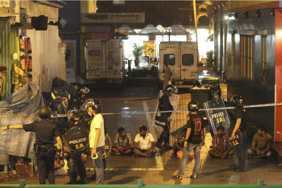 Police detain men following a riot in Singapore's Little India district