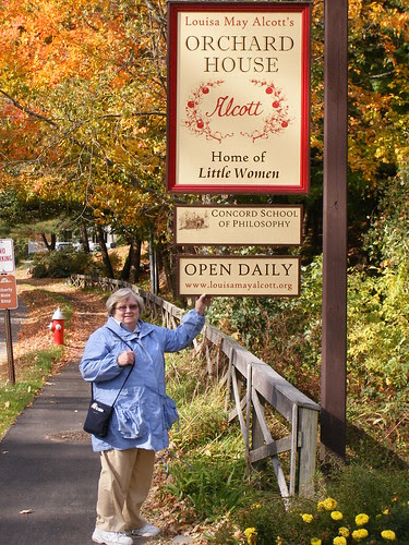 My Mom standing at the sign for Orchard House