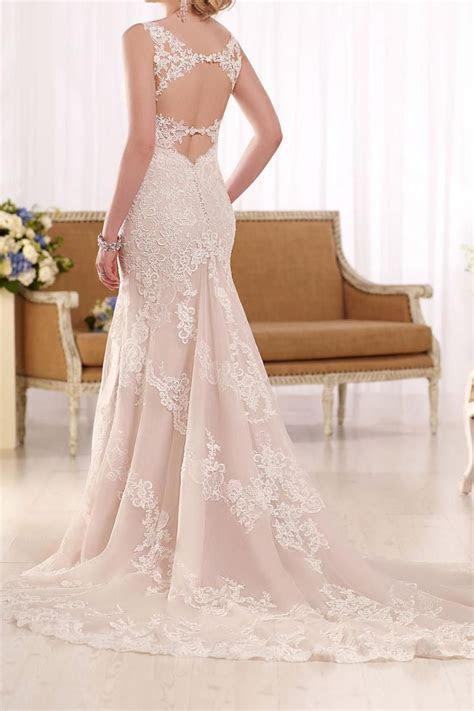 Romantic lace swirls throughout this elegant sheath