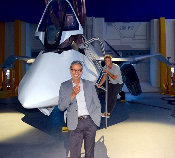 Jeff Goldblum and Liam Hemsworth pose with the alien-hybrid jet fighter that will see combat in INDEPENDENCE DAY: RESURGENCE.