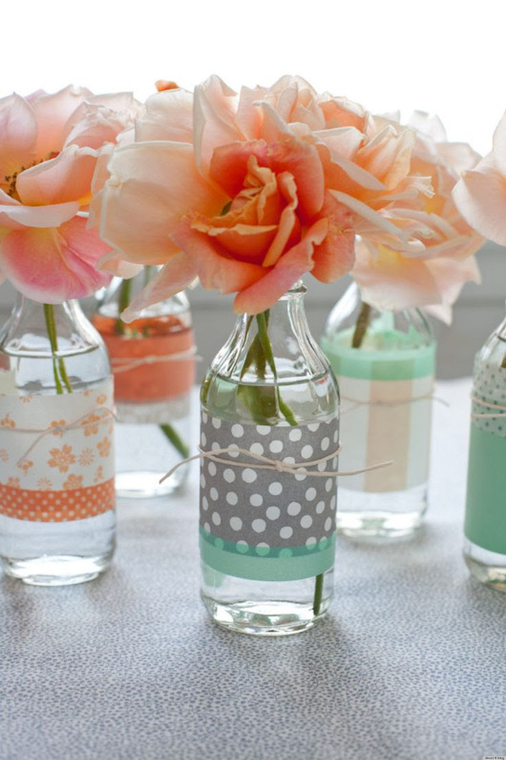 glass bottles wrapped in a piece of scrapbook paper and tied with twine. Good idea for a shower