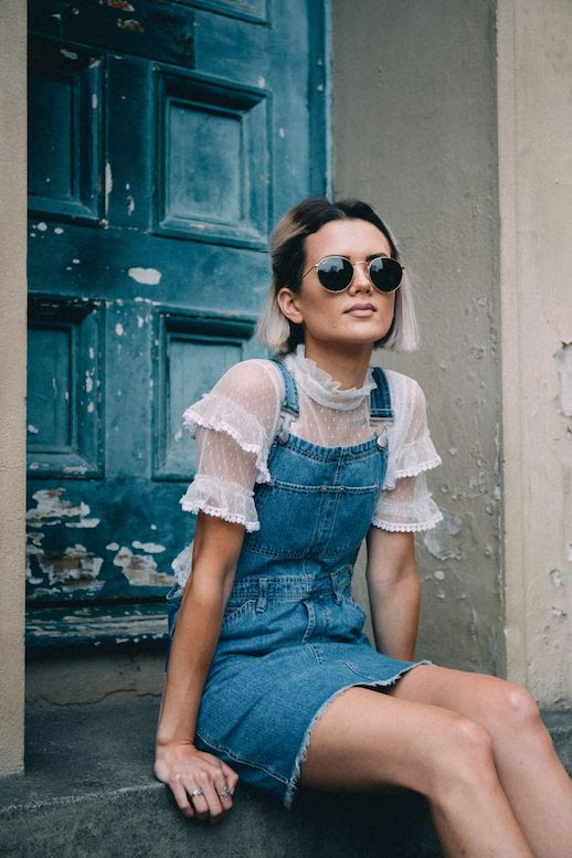 Le Fashion Blog Sheer Lace Ruffle Top Denim Overall Dress Sunglasses Via Chloe Helen Miles