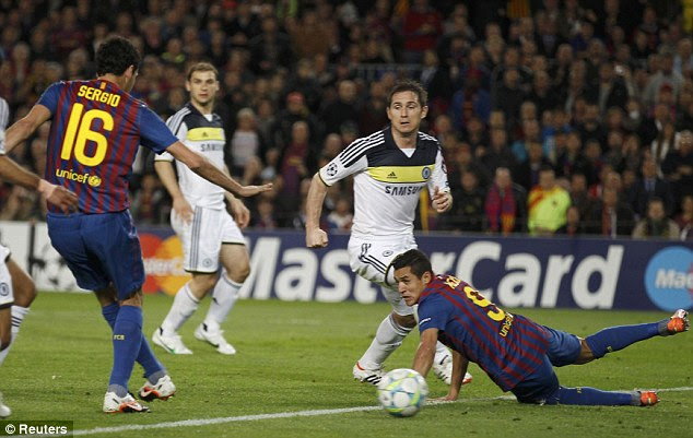 Opener: Busquets opens the scoring on the night - sliding the ball home from seven yards out and celebrates (below)