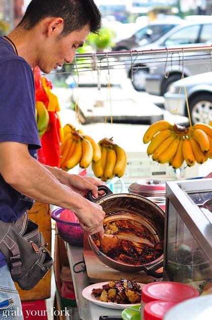 Street vendor making rojak