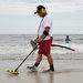 Treasure hunters like Manny Ortiz scour Jones Beach with metal detectors.