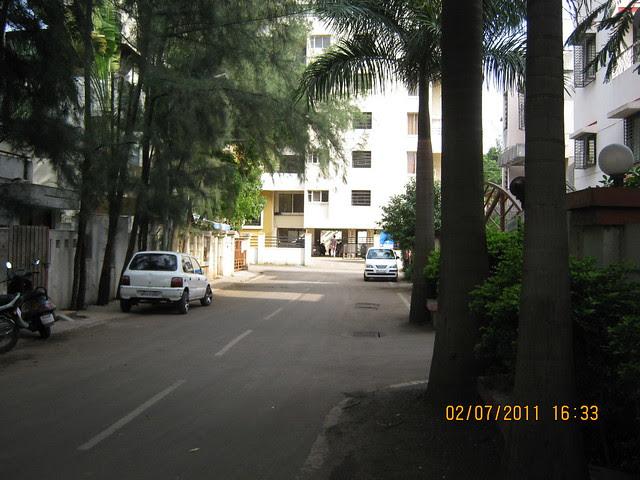 Road to Pate Developers' Kimaya, 2 BHK Flats, Suvarna Nagari, Swami Vivekanand Road, Pune 411 037