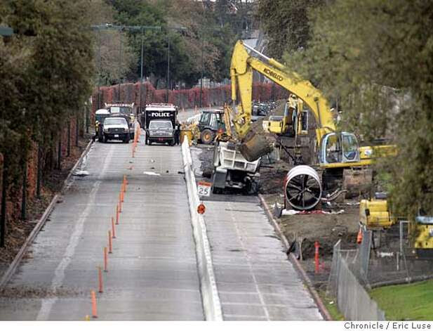 Police officers on Wednesday, Nov. 10, 2004, cordon off the site of a Tuesday explosion in Walnut Creek, Calif. Two people remained missing Wednesday, after an underground fuel pipeline exploded when it was struck accidentally by a construction crew extending a water line. The two missing were part of a construction team that accidentally hit a fuel pipeline. (AP Photo/San Francisco Chronicle, Eric Luse) MAGS OUT MANDATORY CREDIT Metro#Metro#Chronicle#11/13/2004#ALL#5star##0422460631 Photo: ERIC LUSE