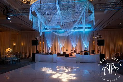 Dramatic swagged chandelier over dance floor (not in blue