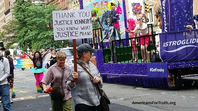"""Justice Anthony Kennedy: Hero of Homosexual Activists: A """"pride"""" marcher gives appropriate thanks to Reagan-appointed Supreme Court Justice Anthony Kennedy--whose pro-""""gay""""advocacy gave homosexuals several key victories at the high court."""
