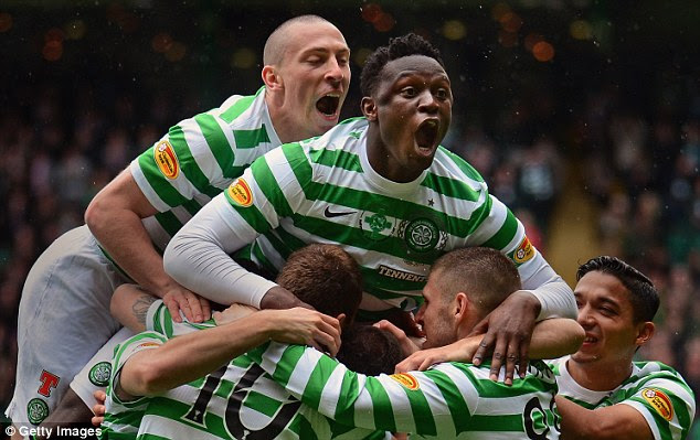 Wanted man: Celtic midfielder Victor Wanyama (centre) is the subject of an improved bid from Cardiff