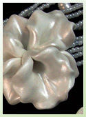 One-of-a-kind necklace with hand-sculpted polymer clay orchid beads